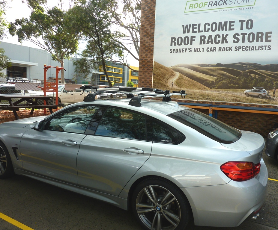BMW 4 series with Whispbar roof racks and 201 bike carriers