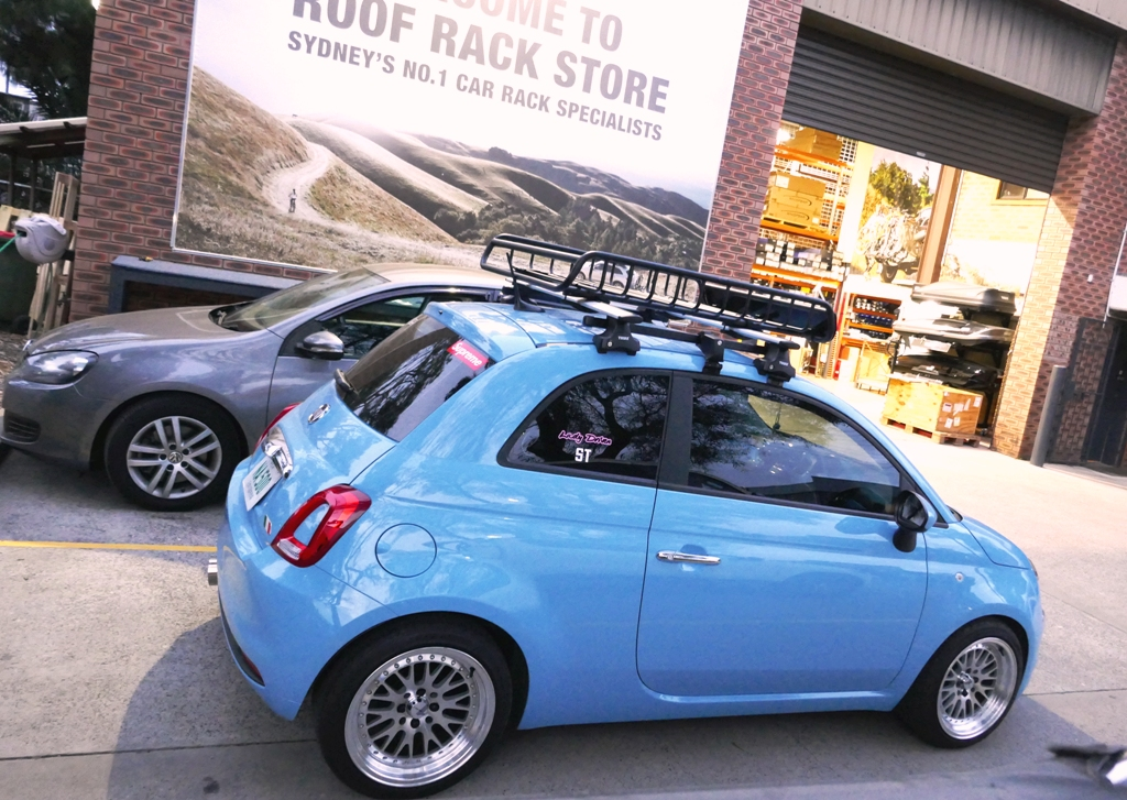 Fiat 500 with Thule Wing Bars and Yakima LoadWarrior roof basket