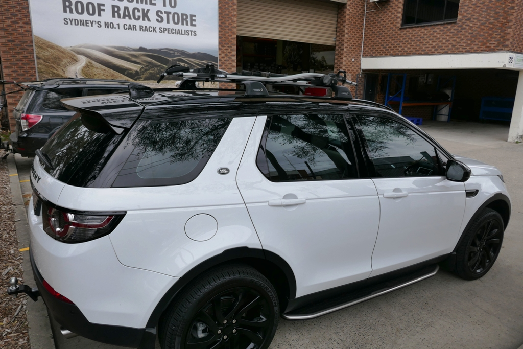 Land Rover Discovery Sport with Whispbar Flush Bars and Thule Proride 598