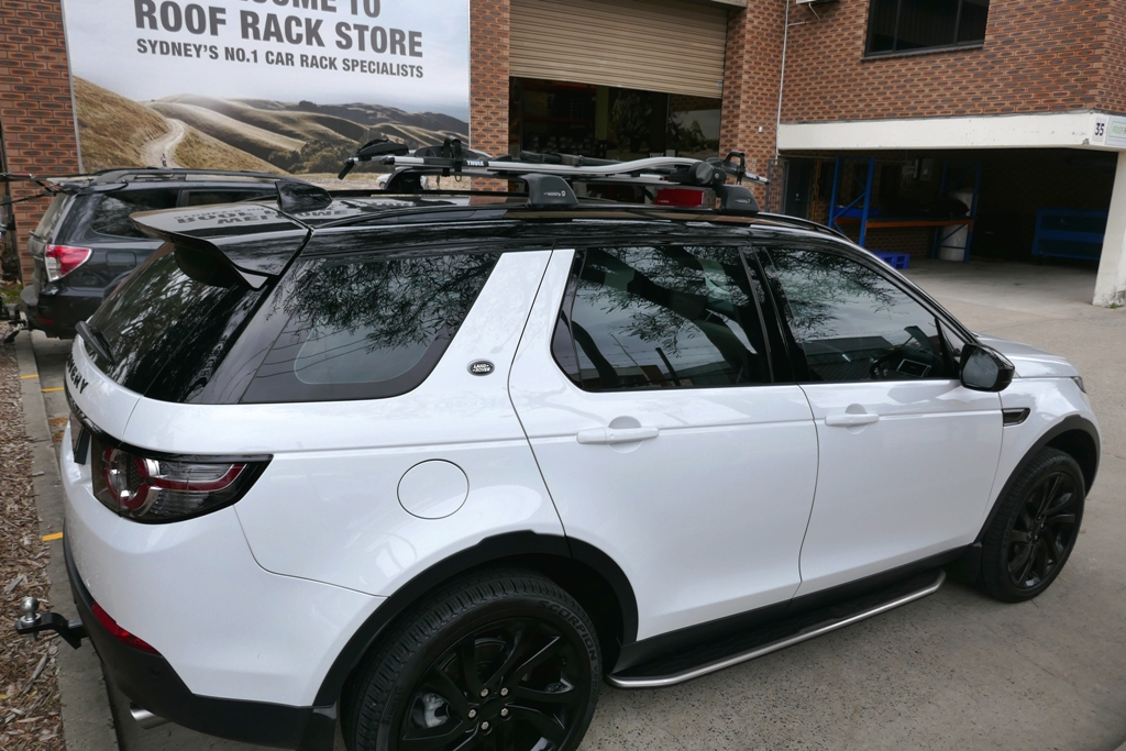 Land Rover Discovery with Whispbar flush racks and Thule Proride