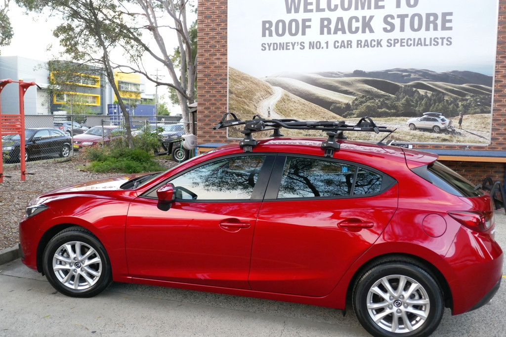Mazda 3 with Thule Wing Bars and 598 ProRides