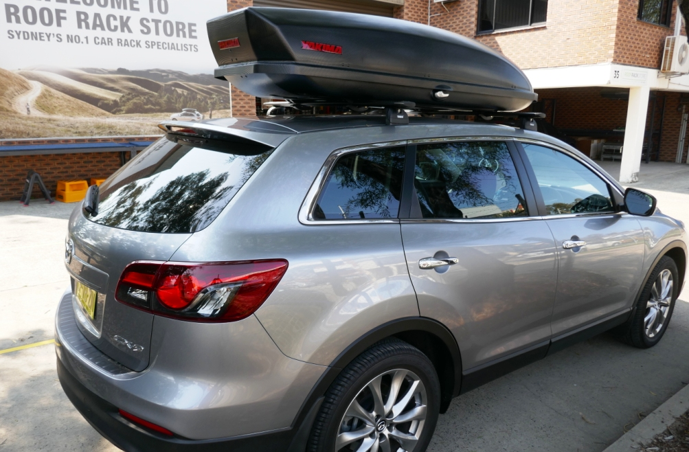 Mazda CX-9 with Thule Wing Bars and Yakima Skybox 21
