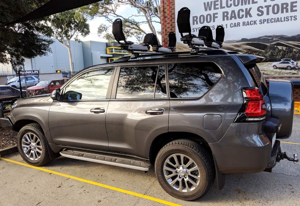 Toyota Prado with twin Thule Hullavators and new EVO bars.