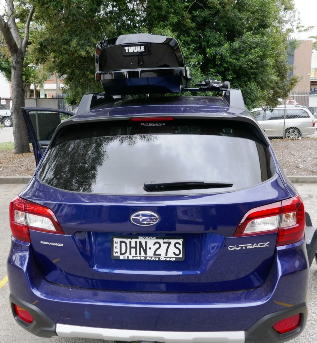 Subaru Outback with Thule Motion Sport and 598 ProRide
