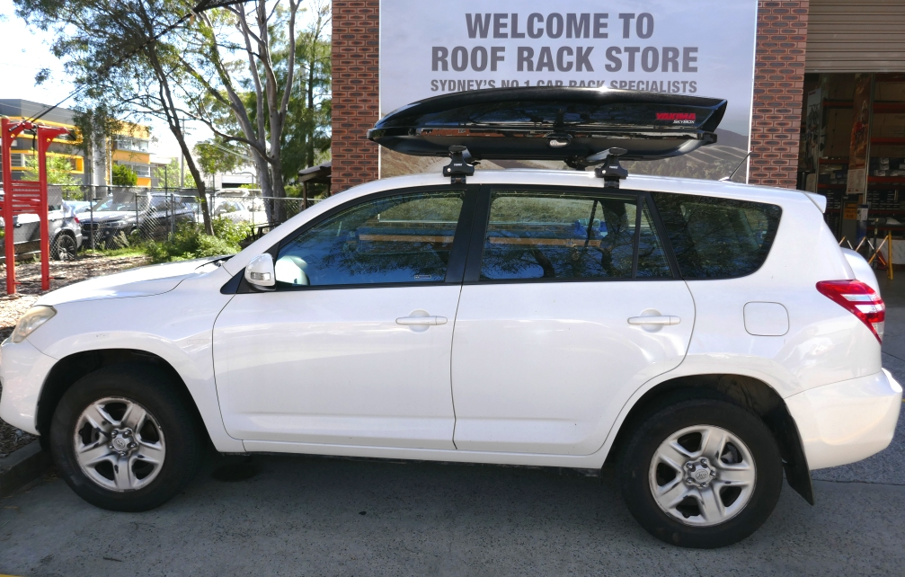 Toyota RAV4 with Thule Wing Bars and Yakima Skybox 16